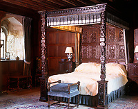 Bedroom in the early Renaissance style with a heavily carved tester bed