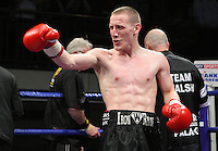 Ryan Walsh (Cromer, Norfolk, black shorts) defeats Marc Callaghan (Barking, brown shorts) in a Featherweight boxing contest at York Hall, Bethnal Green, promoted by Frank Warren / Sports Network - 22/05/09 - MANDATORY CREDIT: Gavin Ellis/TGSPHOTO - Self billing applies where appropriate - 0845 094 6026 - contact@tgsphoto.co.uk - NO UNPAID USE.
