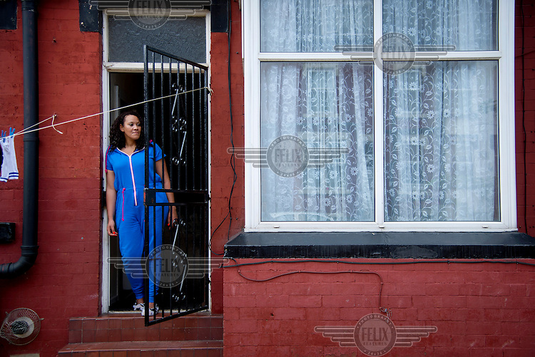 Tracy Pearson stands in the doorway of her home in leeds.