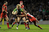 Matt Hopper of Harlequins is tackled by Peter Stringer of Saracens during the Aviva Premiership match between Harlequins and Saracens at Twickenham on Tuesday 27 December 2011 (Photo by Rob Munro)