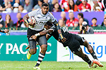 Kalione Nasoko (L) of Fiji is tackled by the New Zealand defence during their Pool A match between Fiji and New Zealand as part of the  HSBC Hong Kong Sevens 2018 on April 7, 2018 in Hong Kong, Hong Kong. Photo by Marcio Rodrigo Machado / Power Sport Images