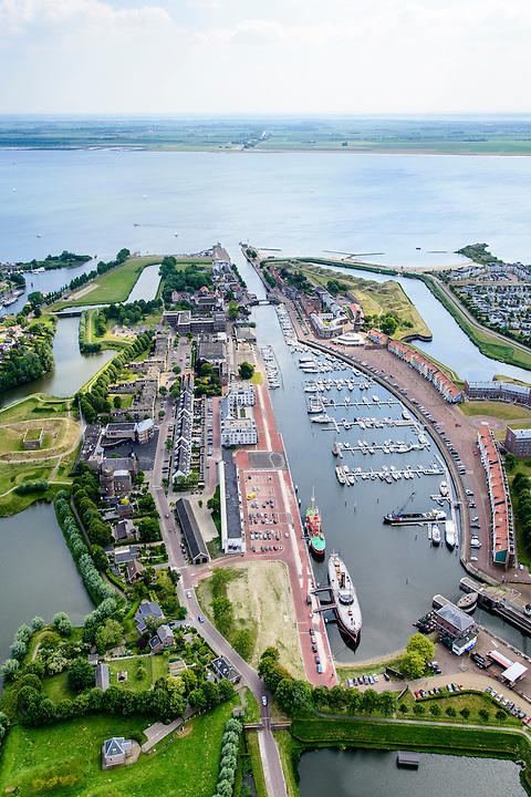 Nederland, Zuid-Holland, Hellevoetsluis 10-06-2015; historische vestingstad en voormalige marinehaven op eiland Voorne-Putten aan het Haringvliet. Droogdok Jan Blanken en Het Grootte Dok (jachthaven en passantenhaven).<br /> Historic fortress and former naval base on the island of Voorne-Putten in the Haringvliet.<br /> luchtfoto (toeslag op standard tarieven);<br /> aerial photo (additional fee required);<br /> copyright foto/photo Siebe Swart