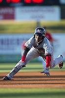 Michael De Leon (1) of the Hickory Crawdads slides head first into third base after hitting a triple in the top of the first inning against the Kannapolis Intimidators at CMC-Northeast Stadium on May 22, 2015 in Kannapolis, North Carolina.  The Intimidators defeated the Crawdads 4-3.  (Brian Westerholt/Four Seam Images)