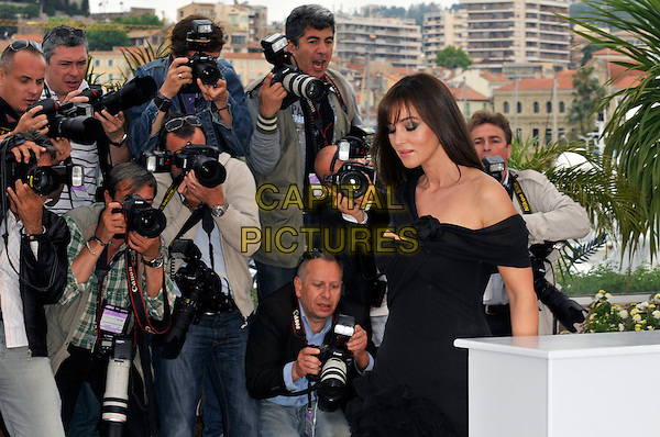 "MONICA BELLUCCI.""Sanguepazzo"" photocall at Palais de Festival during the 61st Cannes International Film Festival, Cannes, France..May 19th, 2008 .half length black black dress off the shoulder photographers press.CAP/PL.© Phil Loftus/Capital Pictures"