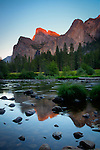 California, Yosemite National Park. Evening light on the mountains and reflections in the Merced River.