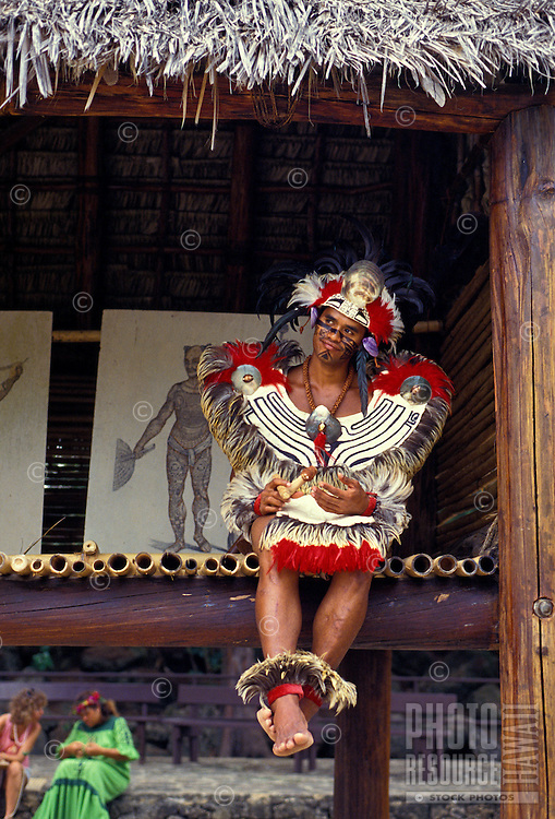 A man in Polynesian costume at the Polynesian Cultural Center, North Shore of Oahu.