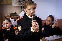 RUSSIA, Moscow, 10.2010. ©  Sergey Kozmin/EST&OST.The Moscow Girls Cadet Boarding School..At lessons of Fundamentals of Military Service the cadets have to study the most common types of weapons. The girl is holding a Makarov handgun.