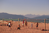 People playing Beach Volleyball at Spanish Banks along English Bay, Vancouver, BC, British Columbia, Canada - Coast Mountains, Summer