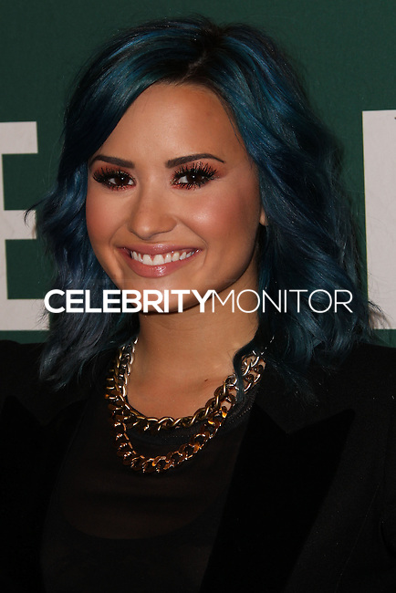 """LOS ANGELES, CA - NOVEMBER 23: Demi Lovato arrives at her book signing for """"Staying Strong: 365 Days a Year"""" held at Barnes & Noble - The Grove on November 23, 2013 in Los Angeles, California. (Photo by Xavier Collin/Celebrity Monitor)"""