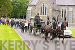 The remains of John Coffey are removed by horse drawn hearse from St Marys Cathedral, Killarney on Friday morning. ..........................................................................................