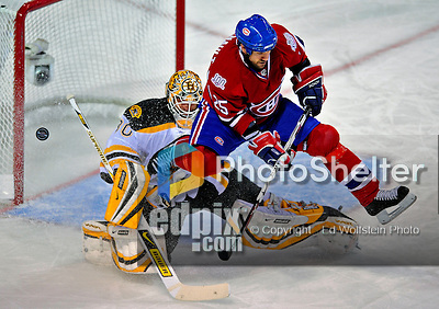 22 April 2009: Montreal Canadiens' defenseman Mathieu Dandenault leaps over Boston Bruins goaltender Tim Thomas as Thomas makes the save in the first period at the Bell Centre in Montreal, Quebec, Canada. The Canadiens, entering the contest down three games to none, were eliminated from Stanley Cup competition with the 4-1 loss and series sweep by the Division winning Bruins. ***** Editorial Sales Only ***** Mandatory Credit: Ed Wolfstein Photo