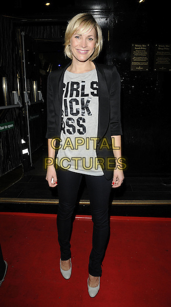 JENNI FALCONER .Attending the Michael Jackson Experience game launch at Whisky Mist, London, England, UK, .November 18th 2010..full length slogan top grey gray t-shirt jacket black blazer shoes jeans skinny  .CAP/CAN.©Can Nguyen/Capital Pictures.
