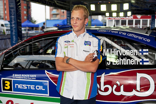 JYVASKYLA, FINLAND - JULY 28: Mikko Hirvonen of Finland pictured with his car on Ford's press meeting on pit area of the WRC Rally Finland on July 28, 2010 in Jyvaskyla, Finland.
