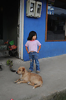 Child and puppy on mainstreet in the tiny village of Mindo, Ecuador.