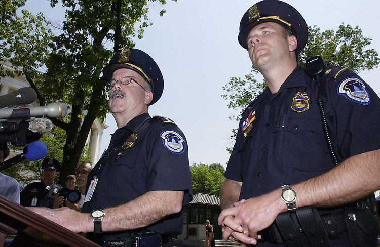 05/11/05.U.S. CAPITOL EVACUATION--Capitol Police Chief Terrance W. Gainer, speaking, and Inspector Philip Morse give a briefing to the media after the all-clear was given. Earlier, the Capitol was evacuated when military jets had scrambled to intercept an unidentified aircraft that violated restricted air space over the Washington area. The all-clear signal was given about 15 minutes after the alarm. .CONGRESSIONAL QUARTERLY PHOTO BY SCOTT J. FERRELL