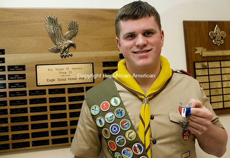 WATERTOWN--16 January 07--011608TJ01 - Patrick O'Connor, 18, holds his Eagle Scout badge from Troop 52 in Oakville at a ceremony at Union Congregational Church in Watertown on Wednesday, January 16, 2008. (T.J. Kirkpatrick/Republican-American)