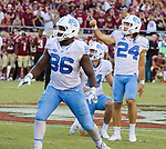 North Carolina kicker Nick Weiler (24) and teammates Carl Tucker (86) and holder Logan Byrd (14) watches Weiler's 54 yard game winning field goal as time expired against Florida State in an NCAA college football game in Tallahassee, Fla., Saturday, Oct. 1, 2016. North Carolina defeated Florida State 37-35. (AP Photo/Mark Wallheiser)