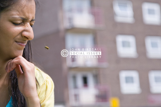 Teenage girl about to be stung by a wasp,