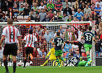 Jermain Defoe (2nd from right) of Sunderland scores their first goalduring the Barclays Premier League match between Sunderland and Swansea City played at Stadium of Light, Sunderland