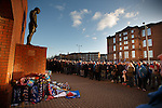 Rangers fans outside the stadium pay their respects to the fans who never returned home