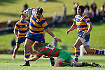 Patumahoe captain Siosuia Pole gets taken around the ankles by Ethan James. Counties Manukau Premier Club Rugby final between Patumahoe & Waiuku played at Bayers Growers Stadium Pukekohe on Saturday August 8th 2009. Patumahoe won 11 - 9 after leading 11 - 6 at halftime.