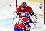 26 October 2009: Montreal Canadiens' goaltender Jaroslav Halak keeps the Habs alive as he makes a save in overtime against the New York Islanders at the Bell Centre in Montreal, Quebec, Canada. The Canadiens defeated the Islanders 3-2 in sudden death overtime for their 4th consecutive win. Mandatory Credit: Ed Wolfstein Photo