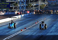 Apr. 1, 2011; Las Vegas, NV, USA: NHRA top alcohol dragster driver Jim Whiteley (right) against Blake Alexander during qualifying for the Summitracing.com Nationals at The Strip in Las Vegas. Mandatory Credit: Mark J. Rebilas-