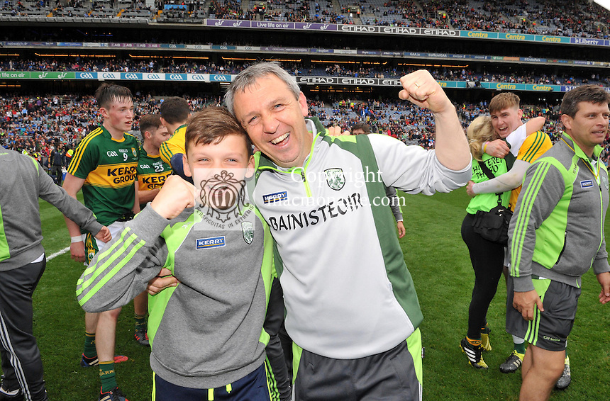 Peter Keane and his son Micheal celebrate on winning the All-Ireland Minor final at Croke on Sunday.<br /> Photo: Don MacMonagle