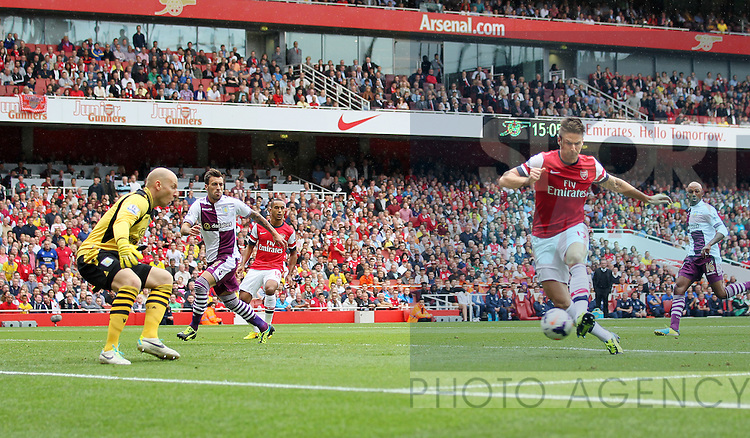 Arsenal's Olivier Giroud scoring his sides opening goal<br /> <br /> Arsenal v Aston Villa  - Barclays Premiership - Emirates Stadium - London - England -17/08/2013  - Pic David Klein/Sportimage
