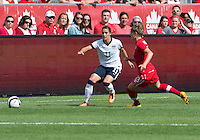 02 June 2013: U.S Women's National Soccer Team defender Ali Krieger #11and Canadian National Women's Soccer Team player Sophie Schmidt #13 in action during an International Friendly soccer match between the U.S. Women's National Soccer Team and the Canadian Women's National Soccer Team at BMO Field in Toronto, Ontario.<br /> The U.S. Women's National Team Won 3-0.