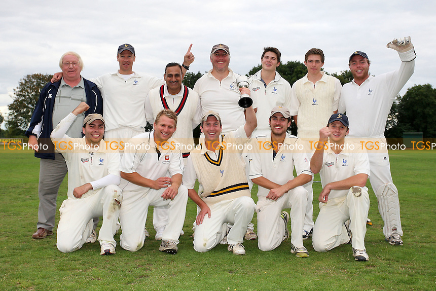 Shenfield players celebrate with the cup - Shenfield CC vs Upminster CC - Dukes Essex Cricket League Cup Final at Wanstead CC - 29/08/11 - MANDATORY CREDIT: Gavin Ellis/TGSPHOTO - Self billing applies where appropriate - 0845 094 6026 - contact@tgsphoto.co.uk - NO UNPAID USE.