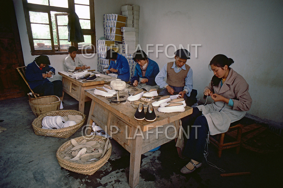 October 1984. In Si Chuan Province, near Cheng Du, a traditional factory for Chinesse shoes, all hand-made, they will sell their production in the same province.