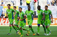 Eddie Johnson (7) of the Seattle Sounders celebrates scoring with teammates  during the first half against the Philadelphia Union during a Major League Soccer (MLS) match at PPL Park in Chester, PA, on May 4, 2013.