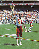 Washington Redskins linebacker Monte Coleman (51) acknowledges the cheers of fans at RFK Stadium in Washington, D.C. as he returns to the locker room prior to the game against the Los Angeles Raiders on September 14, 1986.<br /> Credit: Arnold Sachs / CNP