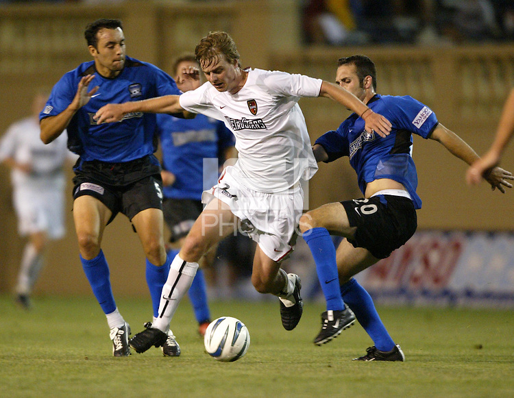 12 June 2004: Eddie Gaven dribbles the ball away from Earthquakes defenders against at Spartan Stadium in San Jose, California.    Earthquakes defeated MetroStars, 3-1.  Mandatory Credit: Michael Pimentel / ISI