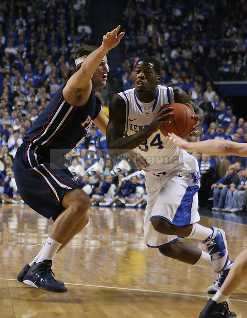 University of Kentucky guard DeAndre Liggins drives towards the basket in the win against the University of Pennsylvania at Rupp Arena in Lexington, KY on January 3, 2011. Photo by Ryan Buckler | Staff