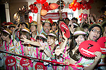 """Tokyo, Japan - Customers pose for cameras inside the Desigual store in Tokyo's Harajuku fashion district. A fashion chain called """"Seminaked Party by Desigual"""" offers the first 100 customers (wearing swimsuit) free clothing items at the grand opening in Tokyo, Japan, June 22, 2013. More than 4,000 people attend the Seminaked Party around the world. (Photo by Rodrigo Reyes Marin/AFLO)"""