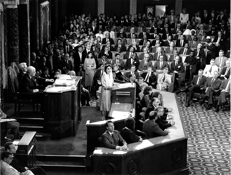 "This photo was taken in a Joint Meeting of Congress in the House Chamber on 7 June 1989.  Here Prime Minister of Pakistan Benazir Bhutto addressed Congress after being elected the first female Prime Minister from a Muslim state in December of 1988.  At the age of 35 in 1989, she recognized the strong relationship between the United States and the Islamic Republic of Pakistan.  One of the more interesting and most notable points she addressed in her speech is the mutual desire for, ""a stable, independent and neutral Afghanistan, an Afghanistan where the people can choose their own system, their own government in free and fair elections.""  This desire would be sought and eventually met in the years to come."