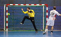 08 JAN 2012 - LONDON, GBR - Austria's Robert Webber (#28, in white) scores a penalty against Great Britain goalkeeper Nicholas Satchwell (#16, in yellow and black) during the men's 2013 World Handball Championships qualification match at the National Sports Centre in Crystal Palace, Great Britain .(PHOTO (C) 2012 NIGEL FARROW)