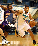SIOUX FALLS, SD - FEBRUARY 12:  Mark Tyndale #11 from the Sioux Falls Skyforce drives past Othyus Jeffers #12 from the Iowa Energy in the first half of their game Tuesday night at the Sioux Falls Arena. (Photo by Dave Eggen/Inertia)