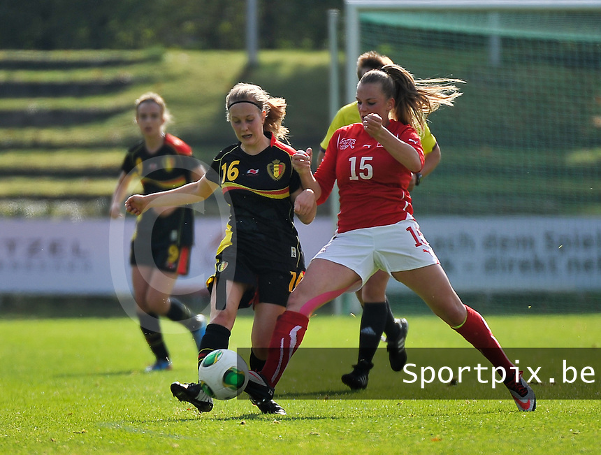 20131013 - BAMBERG , GERMANY :  Belgian Celien Guns (16) pictured with Swiss Camille Surdez (15)  during the female soccer match between Switzerland Women U17 and Belgium U17 , in the second game of the Elite round in group 6 in the UEFA European Women's Under 17 competition 2013 in the Fuchs Park Stadion - Bamberg  Sunday 13 October 2013. PHOTO DAVID CATRY