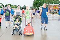 A family from Davenport, Iowa, walks on the Grand Concourse  on a rainy day at the Iowa State Fair in Des, Moines, Iowa, on Sun., Aug. 11, 2019.
