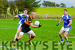 Stacks Kieran Donaghy tries to get away from KOR's  Shane Brosnan and Con Barrett and Roddy O'Donnell in the Memorial Cup Senior Football Championship Final Austin Stacks V Kerins O'Rahilly at Ballymac GAA Ground on Sunday