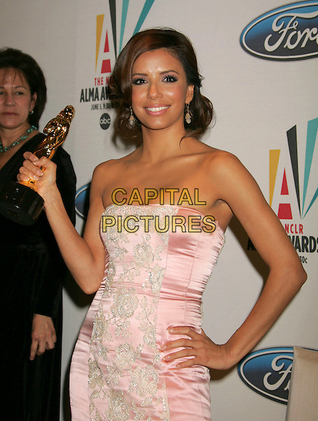 EVA LONGORIA.Press conference for the 2006 American Latino Media Arts Awards held at the Peninsula Hotel, Beverly Hills, California, USA, 04 April 2006..half length award trophy pink strapless satin lace dress hand on hip.Ref: ADM/RE.www.capitalpictures.com.sales@capitalpictures.com.©Russ Elliot/AdMedia/Capital Pictures.