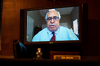 """Georges Benjamin, Executive Director of the American Public Health Association testifies through teleconference speaks during the US Senate Health, Education, Labor, and Pensions Committee hearing titled """"COVID-19: Going Back to School Safely"""" on Capitol Hill in Washington, DC on Thursday, June 4, 2020.<br /> Credit: Ting Shen / CNP/AdMedia"""