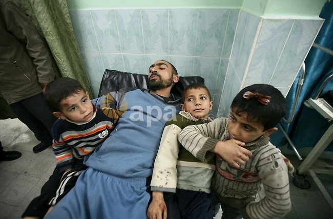 Wounded Palestinian children receive medical atttention at a hospital in Beit Lahia in the northern Gaza Strip on March 12, 2012, following an Israeli air raid. Israeli war planes carried out new air strikes on Gaza overnight, wounding 35, after Israel's premier vowed no let-up against rocket-firing militants. Photo by Ali Jadallah