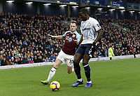 Everton's Kurt Zouma under pressure from  Burnley's Ashley Barnes<br /> <br /> Photographer Rich Linley/CameraSport<br /> <br /> The Premier League - Burnley v Everton - Wednesday 26th December 2018 - Turf Moor - Burnley<br /> <br /> World Copyright &copy; 2018 CameraSport. All rights reserved. 43 Linden Ave. Countesthorpe. Leicester. England. LE8 5PG - Tel: +44 (0) 116 277 4147 - admin@camerasport.com - www.camerasport.com