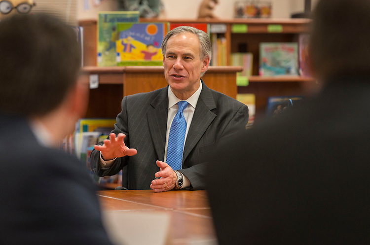 Governor Greg Abbott talks with Houston ISD administrators during a visit to the School at St. George Place, February 26, 2015.