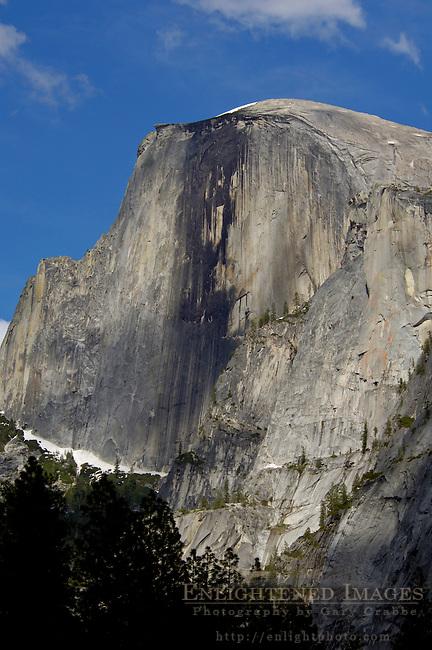 Looking up at sheer granite cliff face of Half Dome above Yosemite Valley, Yosemite National Park, California