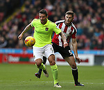 Jack O'Connell of Sheffield Utd tussles with Marc Richards of Northampton during the English League One match at Bramall Lane Stadium, Sheffield. Picture date: December 31st, 2016. Pic Simon Bellis/Sportimage